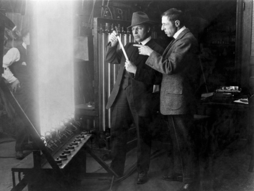 "In this 1913 publicity image released by TCM, G.W ""Billy"" Bitzer, center, and D.W Griffith discuss early lighting techniques in a scene from seven-part documentary series ""Moguls & Movie Stars: A History of Hollywood"" beginning Monday, Nov. 1, 2010 on the Turner Classic Movie channel. (AP Photo/TCM) ** FOR ONE-TIME EDITORIAL USE ONLY WITH JAKE COYLE'S STORY: TV-MOGULS AND MOVIE STARS. NO SALES. **"